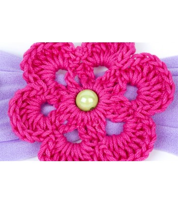 Hand Knitted Flowers Adorn a Lilac Headband
