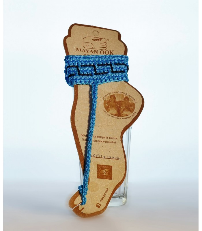 Hand embroidered knit ankle bracelet in blue.