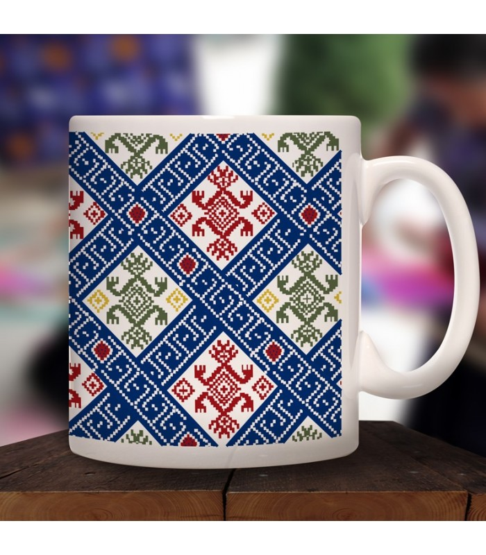 Larráinzar collector's mug in ceramic with designs representing Chiapas textile styles.